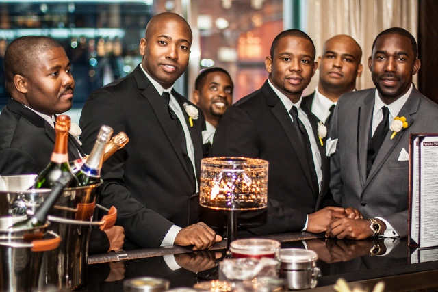 groomsmen and groom at bar during wedding