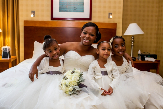 flower girls and bride before wedding