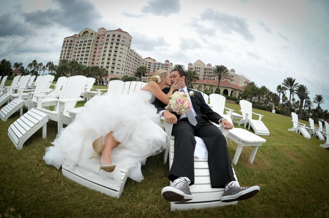 bride and groom kiss on lawn chairs