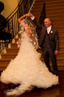 groom twirls bride