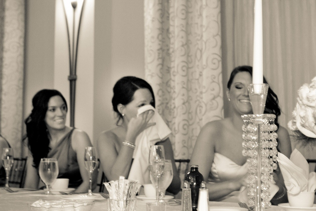 bridesmaids laugh at wedding toast