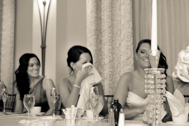 bridesmaids laugh at wedding toast