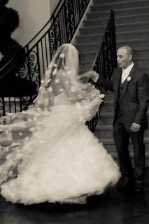 bride and groom dance at stairs