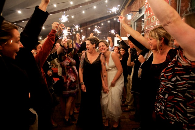 brides leave wedding with sparklers