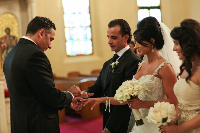 Greek Orthodox wedding bride and groom exchange rings