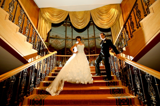 Four Seasons hotel bride shows off on stairs