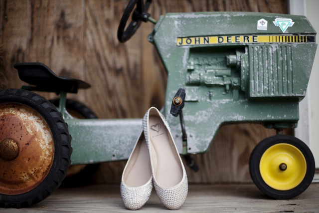 wedding shoes next to toy tractor