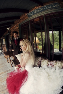 bride and groom with red accents