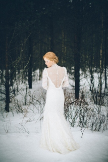 back of bride's wedding dress in snow, long sleeve dress