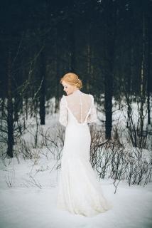 back of bride's wedding dress in snow, long sleeve dress