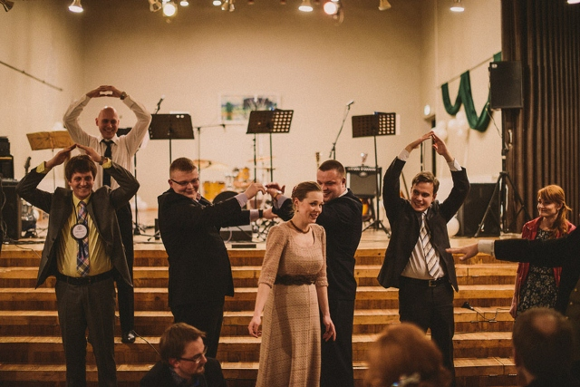 guests dance in church at wedding