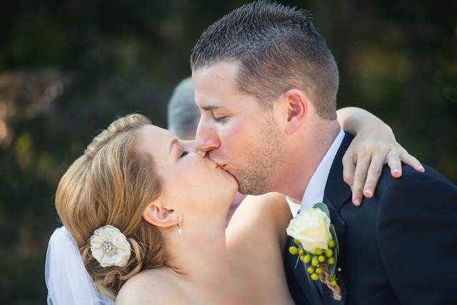 ceremony kiss bride and groom