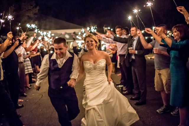 sparklers as couple leaves wedding