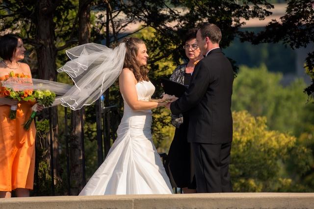 wedding ceremony bride's veil blows in wind