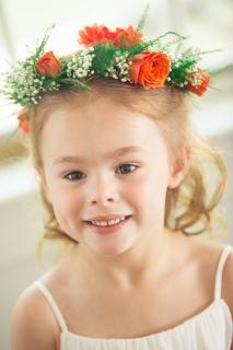 orange flower wreath on flower girl