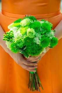 green flowers orange dress bridesmaids