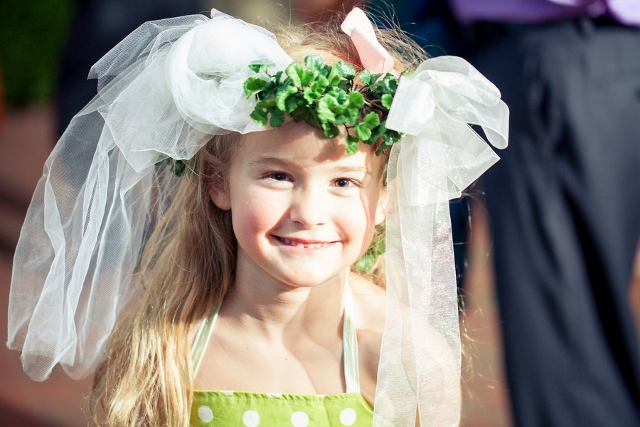 green wreath on flower girl