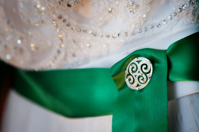 green irish sash on wedding dress