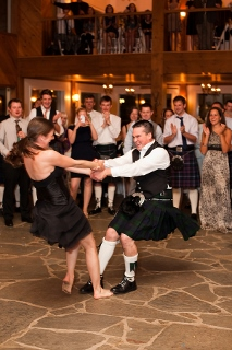 couple in kilts dance