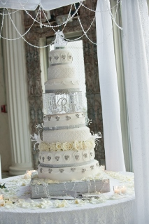 three tiered white wedding cake