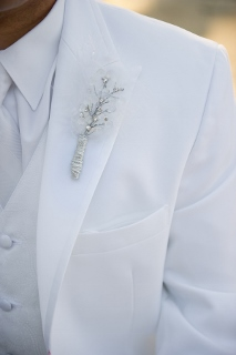 white suit boutonniere on groom