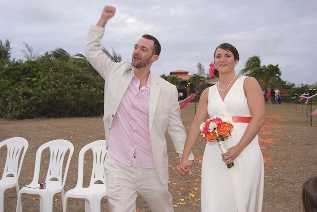 beach wedding groom celebrates