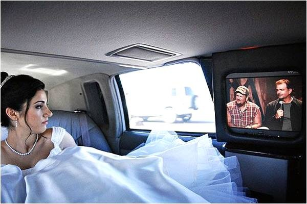 bride watching tv in limo