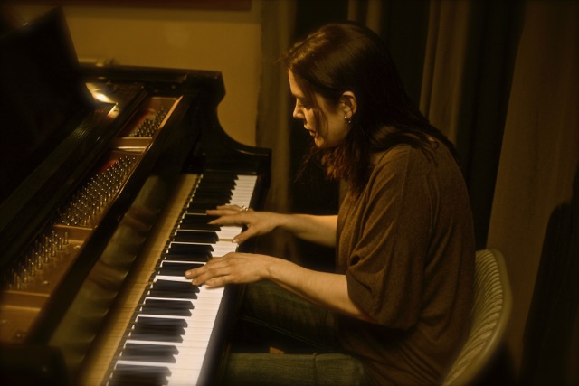Playing the piano is among Holley's many musical talents